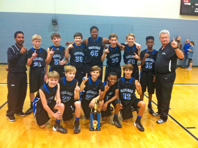 Chelsea Middle School boys basketball team displays the 2014 Southern Conference Champion