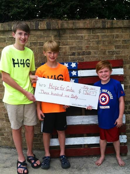 Walker and Colin Gailey present Gabe with $360.