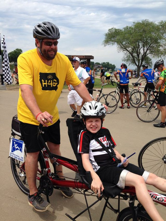 Gabe rides with his father Scott