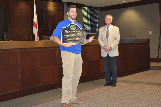 Blake Lovett with historical plaque