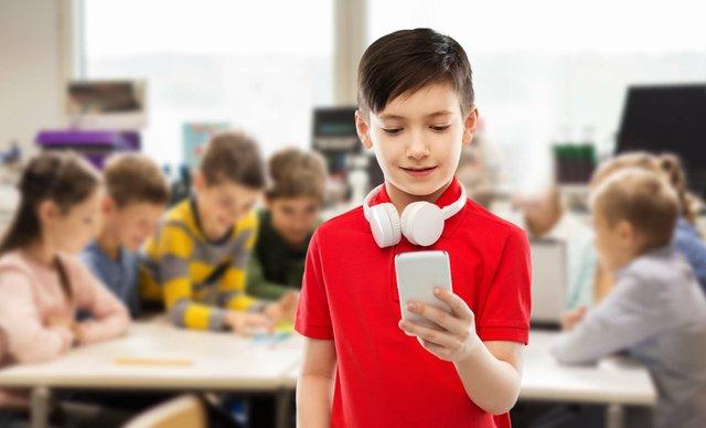 boy with headphones in class