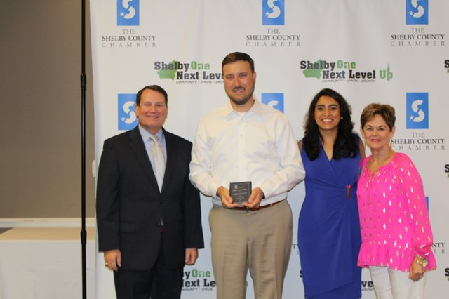 Joseph A. Zanthos, D.M.D. at Premier Family Dentistry accepts his award from the Shelby Chamber